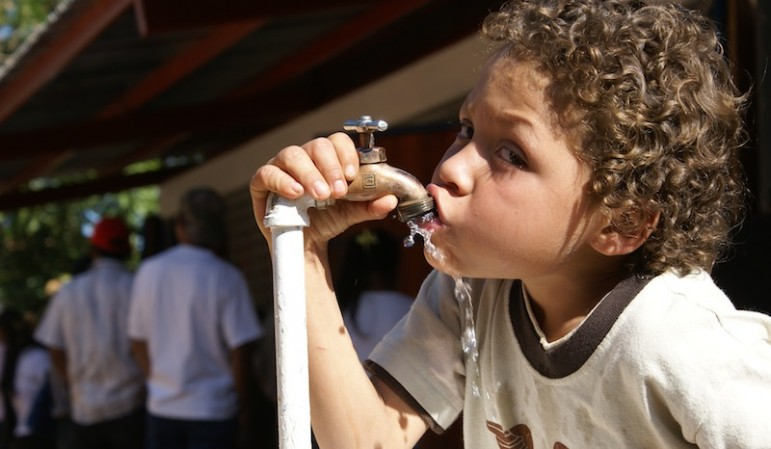 Have a drink on me: A Nicaraguan boy on the Atlantic coast drinks from a World Bank-funded water project
