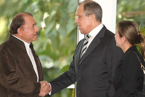 Nicaraguan President Daniel Ortega (l.) greets Russian Foreign Minister Sergey Lavrov during his arrival for a meeting at the presidential house in Managua, Nicaragua, Wednesday.